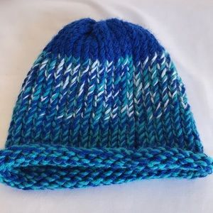 Knitted blue, teal, and white beanie hat